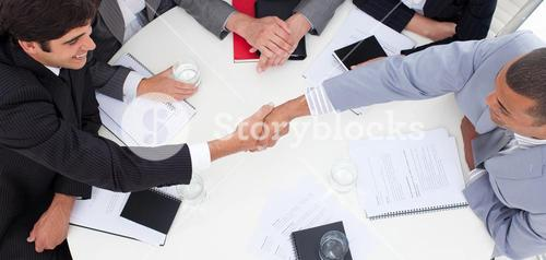 Close up of successful business people closing a deal