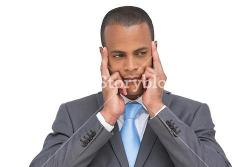 Young businessman putting his fingers on his temples