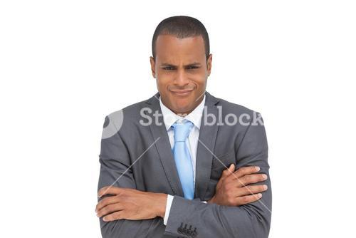 Doubtful businessman with arms crossed