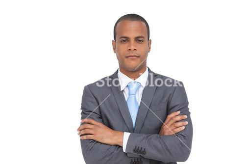 Charismatic businessman with arms crossed