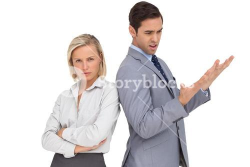 Blonde businesswoman angry against her colleague arguing