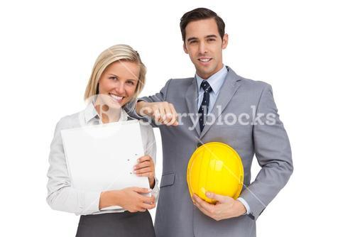 Architects with plans and hard hat
