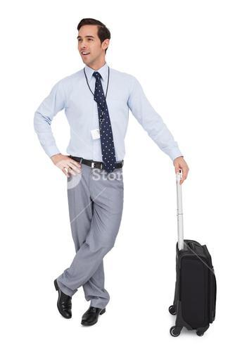 Smiling businessman waiting with his luggage
