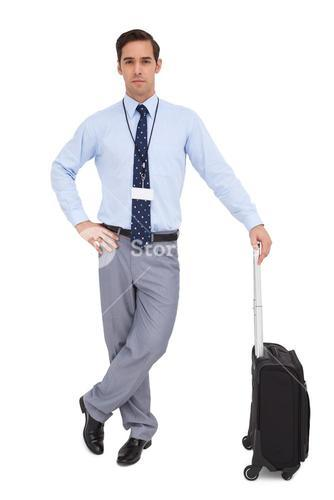 Handsome young businessman waiting with his suitcase