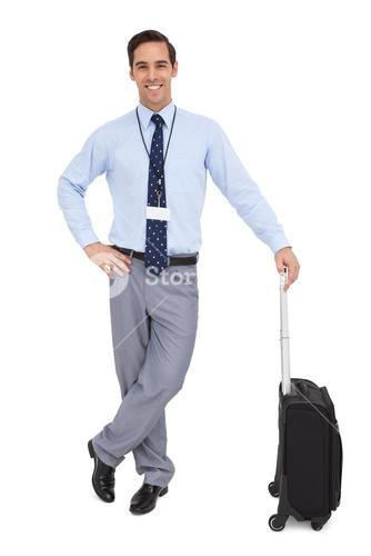 Handsome businessman standing with his suitcase