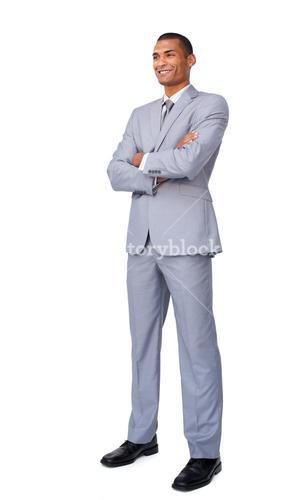 Charismatic Attractive businessman with folded arms