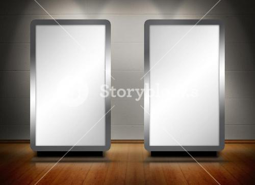 Two blank screens standing on wooden floor