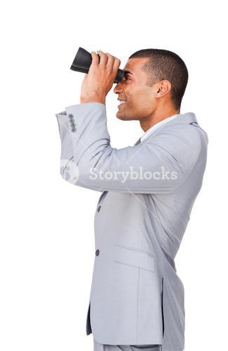 Young businessman using binoculars