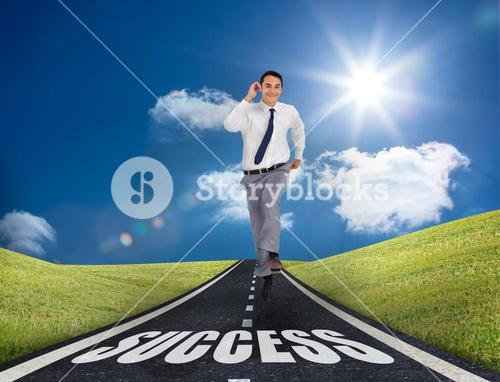 Happy businessman running on a road