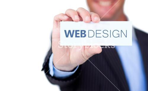 Businessman holding a label with web design written on it