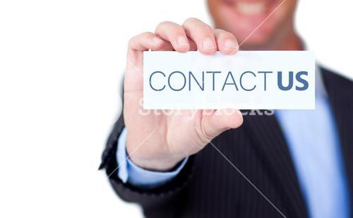 Businessman holding a label with contact us written on it