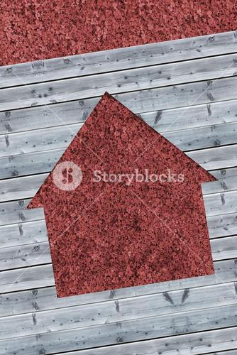Cut wooden boards forming house with red texture