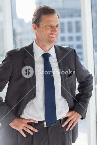 Businessman with his hands on hips