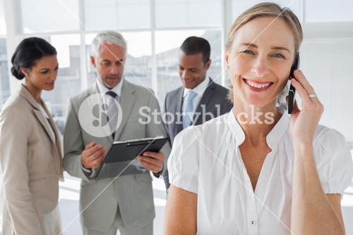 Smiling woman on a phone conversation