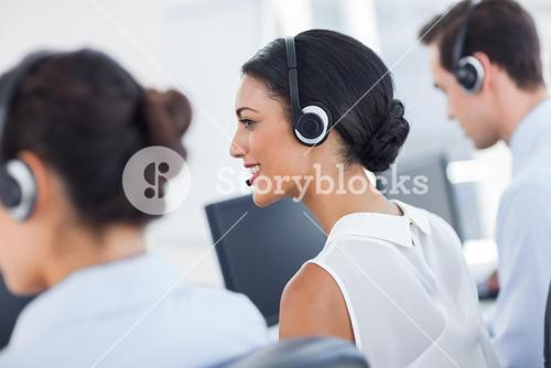 Three call centre employees working