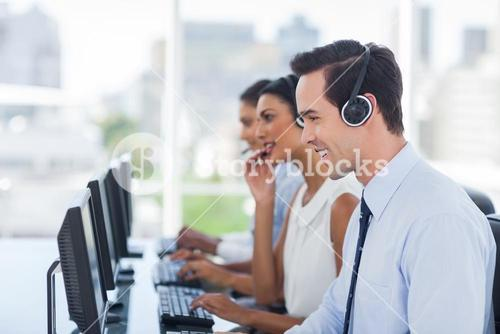 Smiling agent working in a call centre
