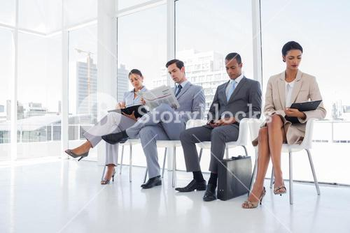 Well dressed business people sat together