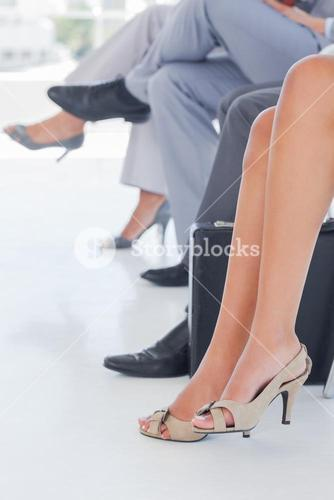 Legs of business people in line