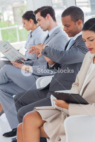 Business people sat in line