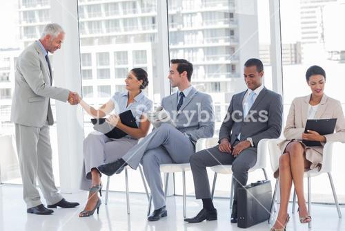 Director welcoming a businesswoman