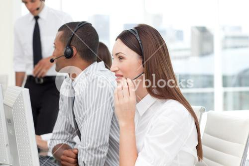Happy Business team with headset on