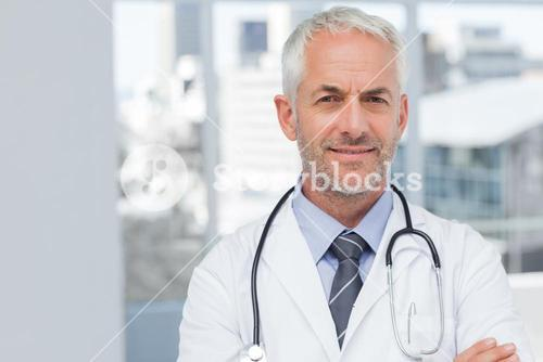 Doctor standing with arms folded