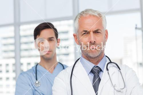 Two serious doctors standing