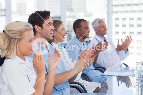 Doctors clapping their hands