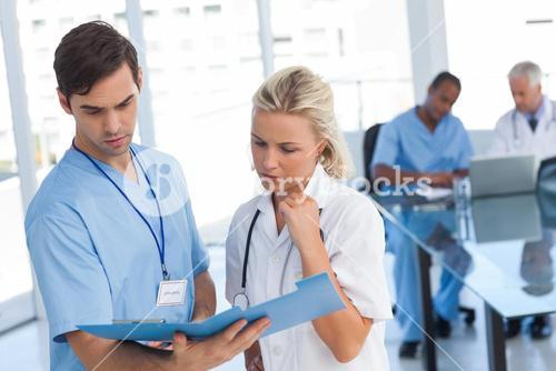 Two doctors examining a file