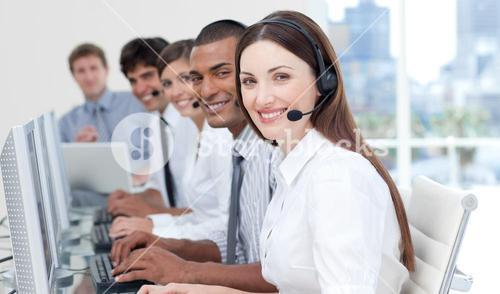 Smiling business people with headset on