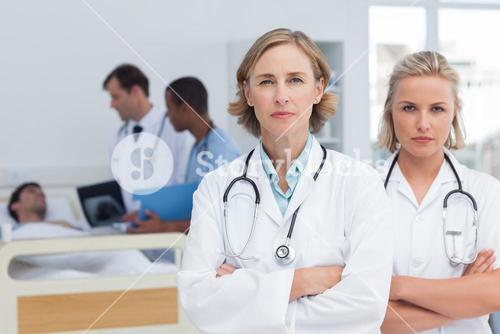 Two serious women doctors standing