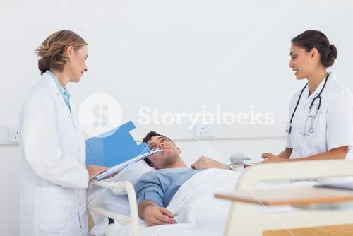 Doctors explaining the symptoms to a patient