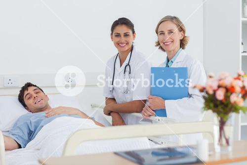 Patient and doctors looking at the camera