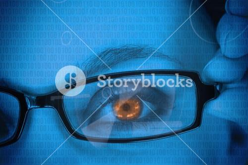 Woman with orange eye wearing glasses