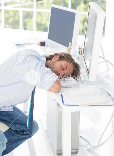 Designer asleep at his desk