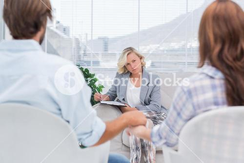 Therapist listening to couple during a session