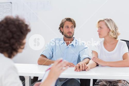 Couple looking doubtful during therapy session