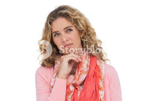 Thoughtful attractive woman standing alone