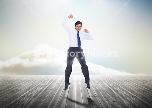 Businessman jumping over wooden boards