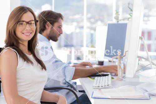 Portrait of smiling designer with reading glasses
