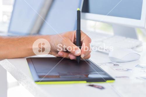 Male hands using graphics tablet