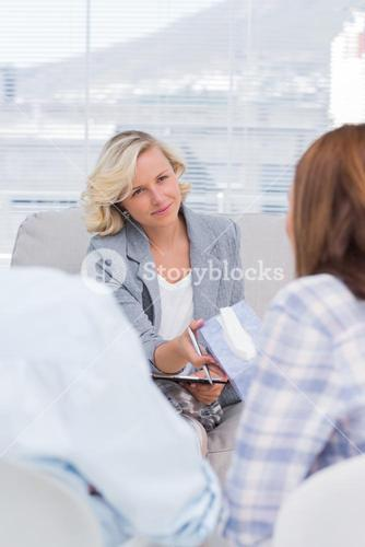 Therapist giving tissue to the wife