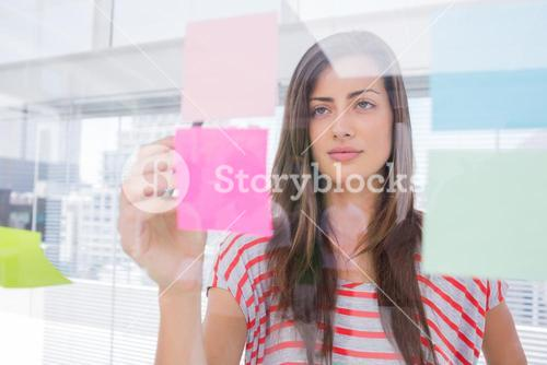 Woman checking sticky note