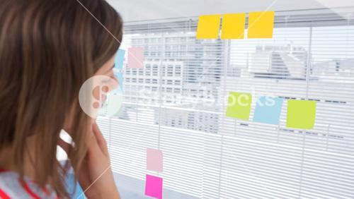 Woman looking at sticky note