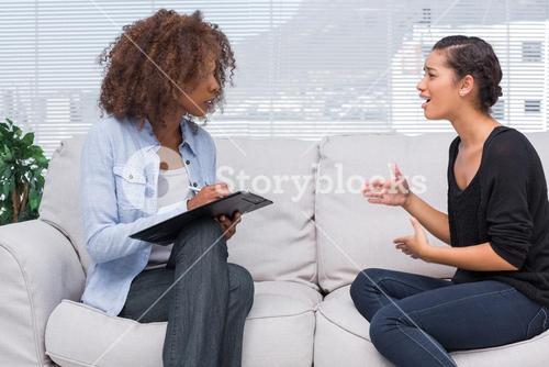 Woman gesturing and speaking to her therapist