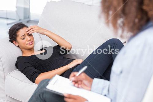 Woman crying at therapy