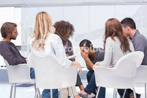 Therapist listening a woman crying