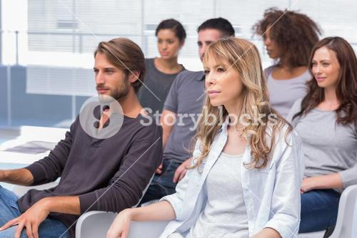 Group of patients listening at therapy