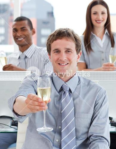 Close up of successful business team drinking champagne