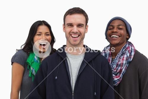 Stylish young friends laughing at camera